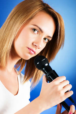 kareoke: Girl singing with microphone against gradient background