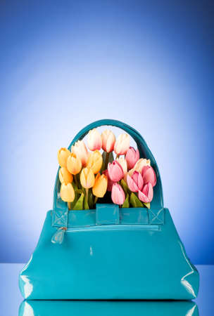 Bag and flowers against the colorful background photo