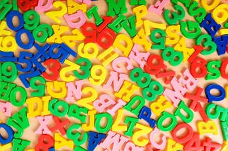 numeracy: Children letters and digits on the table
