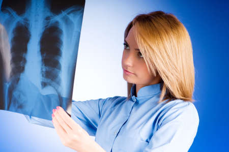 Female doctor carefully x-ray of patient photo