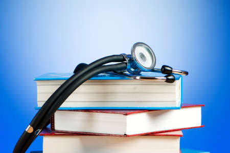 Books and stethoscope against the gradient background Stock Photo - 7867561