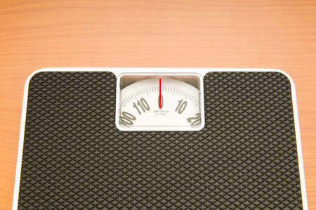 Dieting concept with scales on the wooden floor Stock Photo - 7915318