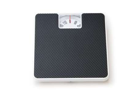 Dieting concept with scales isolated on the white Stock Photo - 7915116