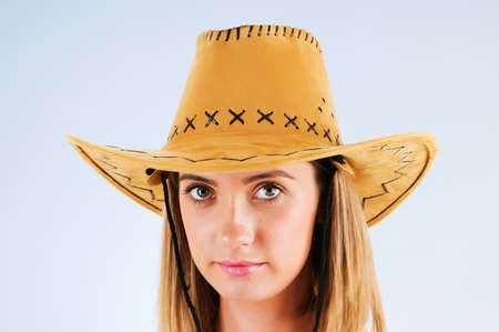 Young girl wearing cowboy hat in the studio photo