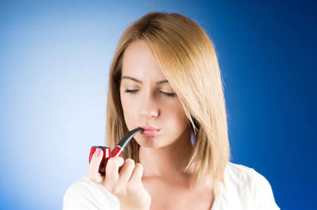 Girl smoking pipe against the gradient background Stock Photo - 7941362
