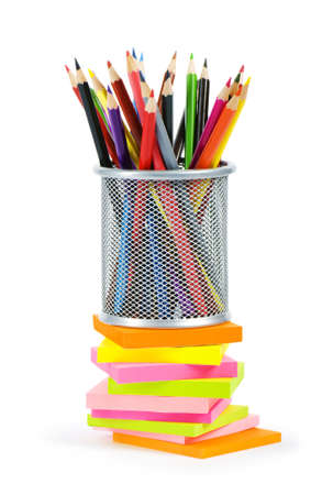 Reminders and color pencils isolated on the white photo