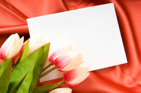 Envelope and flowers on the satin background photo