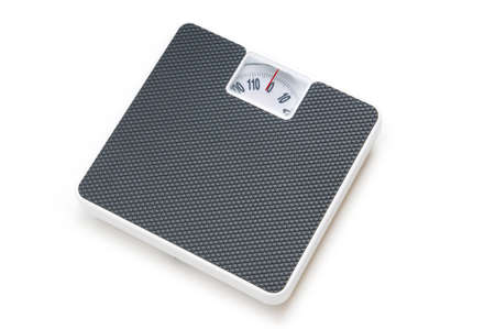 Dieting concept with scales isolated on the white Stock Photo - 8028362