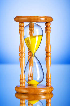 Time concept - hourglass against the gradient background Stock Photo - 8028885
