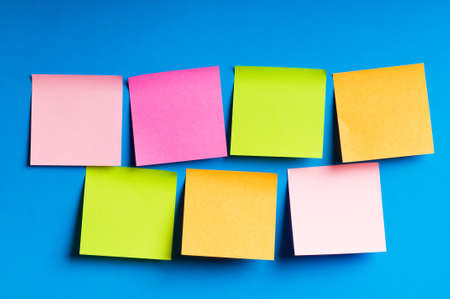 bulletin board: Reminder notes on the bright colorful paper