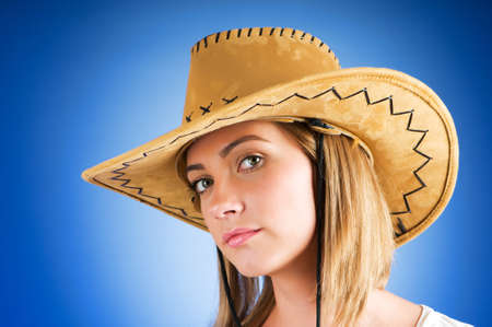 cowboy background: Young girl wearing cowboy hat in the studio