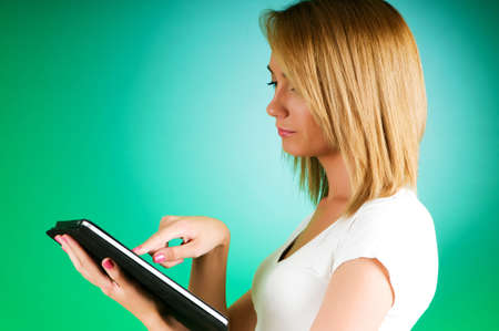 Girl working with the portable tablet computer photo