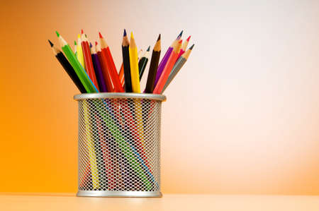 Set of colorful pencils in the holder photo