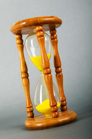 Time concept - hourglass against the gradient background Stock Photo - 8028838