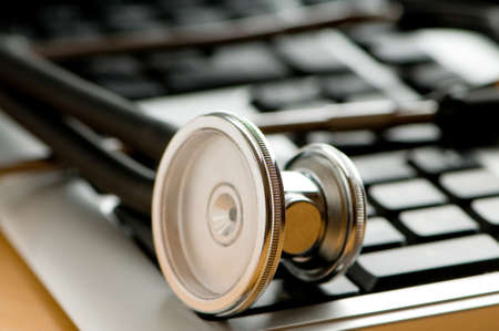 laptop repair: Stethoscope and keyboard illustrating concept of digital security