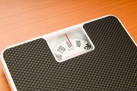 Dieting concept with scales on the wooden floor Stock Photo - 8054902