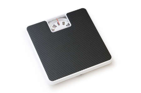 Dieting concept with scales isolated on the white Stock Photo - 8059760