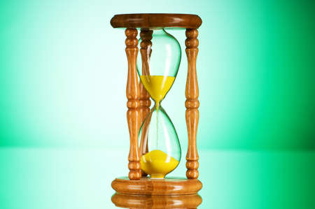 Time concept - hourglass against the gradient background Stock Photo - 8059548
