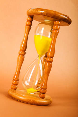 Time concept - hourglass against the gradient background Stock Photo - 8059695