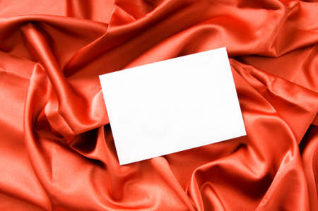 Blank message on the red satin background photo