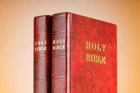Bible books against the colorful gradient background photo