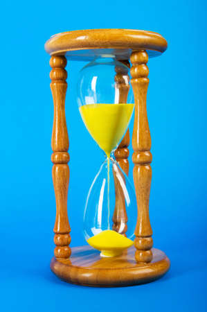Time concept - hourglass against the gradient background Stock Photo - 8137116