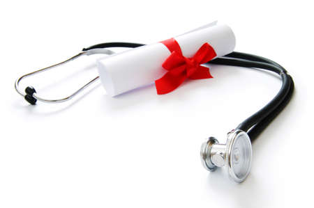 Education concept with diploma and stethoscope on white Stock Photo - 8208915