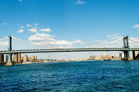 Brooklyn bridge in New York on bright summer day photo