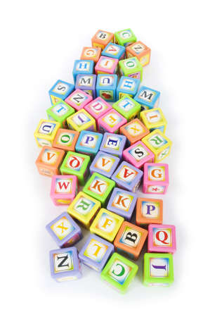Learning and education concept - pile of alphabet blocks photo