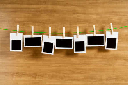 pegs: Designer concept - blank photo frames for your photos Stock Photo