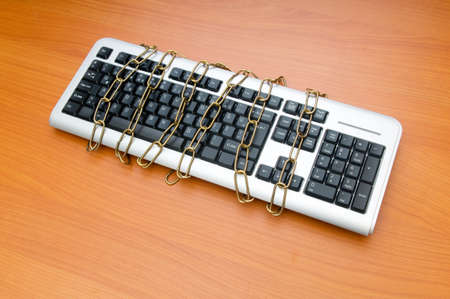 Computer security concept with keyboard and chain Stock Photo - 8234280