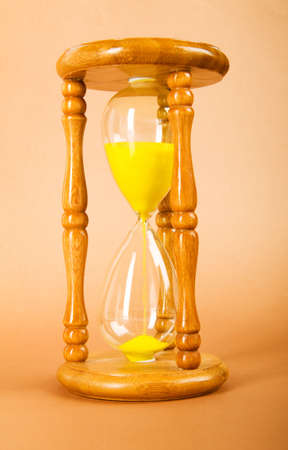 Time concept - hourglass against the gradient background Stock Photo - 8233739