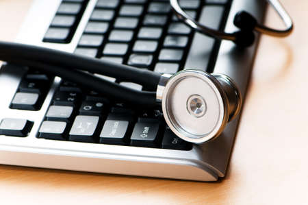 Stethoscope and keyboard illustrating concept of digital security  photo