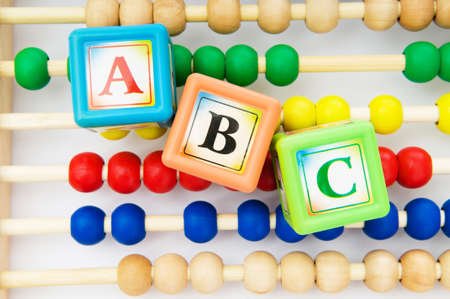 Alphabet blocks and abacus isolated on white photo
