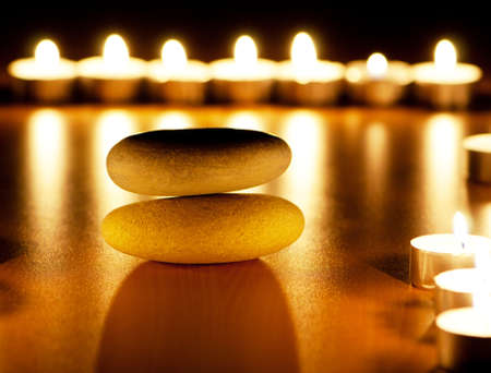 Burning candles and pebbles for aromatherapy session photo