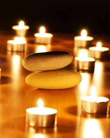 alternative wellness: Burning candles and pebbles for aromatherapy session