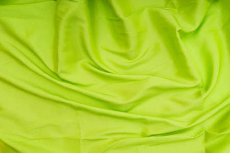Bright satin fabric folded to be used as background photo
