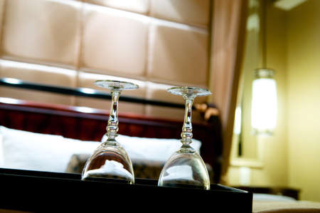 Two glasses on the double bed as romantic concept Stock Photo - 8365424