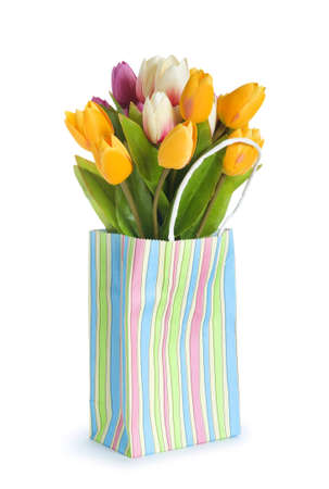 Tulips in shopping bag isolated on white photo