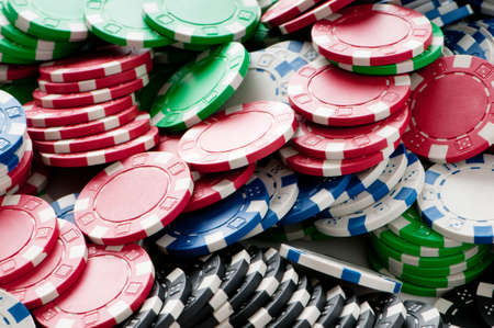Stack of various casino chips - gambling concept photo