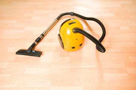 Vacuum cleaner on the polished wooden floor  photo