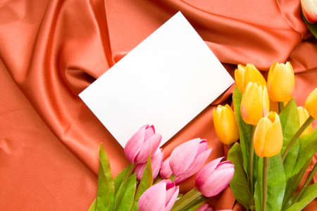 Envelope and flowers on the satin background Stock Photo - 8400236