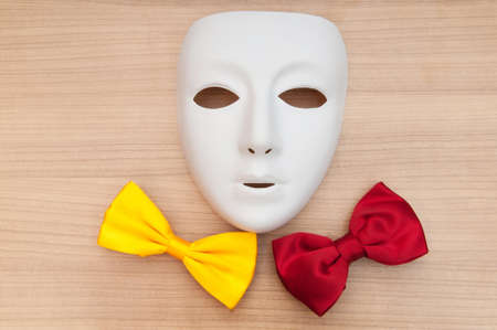 Masks and bow ties on the wooden background Stock Photo - 8400316