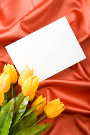 Envelope and flowers on the satin background Stock Photo - 8460100