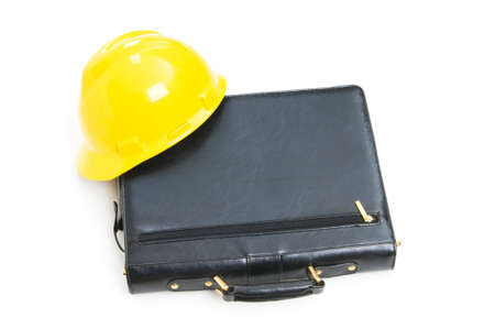 Construction concept - case and hard hat isolated on white photo