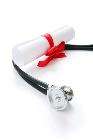 Education concept with diploma and stethoscope on white Stock Photo - 8455478