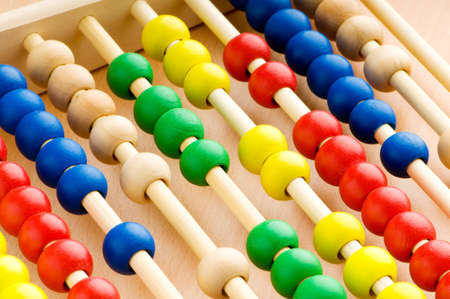 Education concept - Abacus with many colorful beads photo