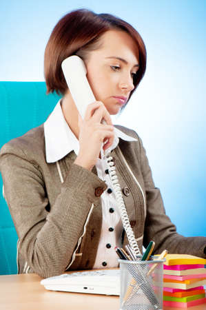 Young businesswoman talking on the phone photo