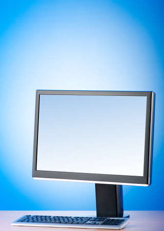 Wide screen computer monitor against colorful background Stock Photo - 8459959