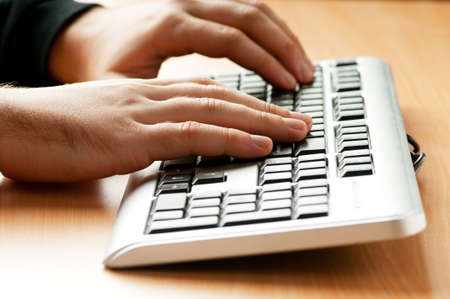 Two hands working on the silver keyboard Stock Photo - 8460074